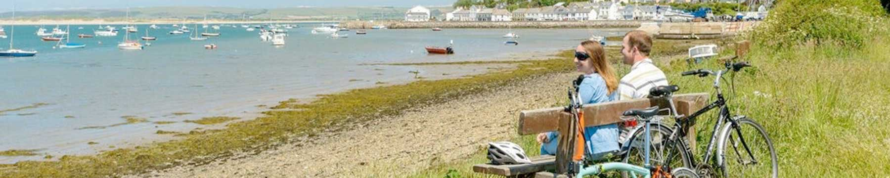 Couple relax on bench along the Tarka Trail at Instow