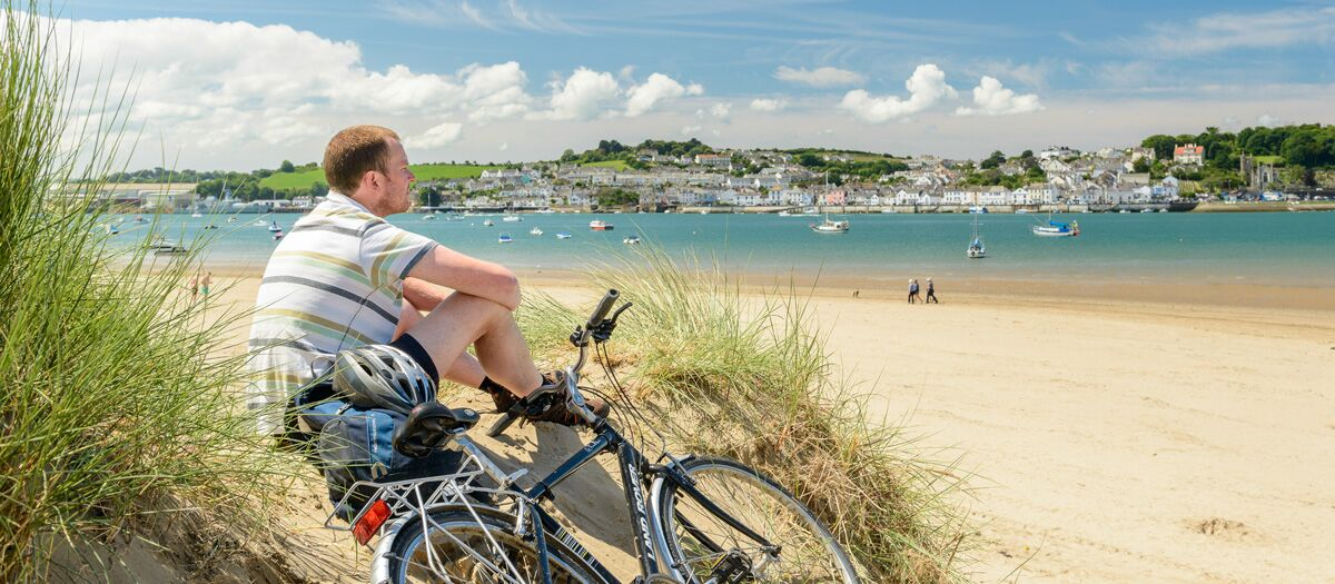 Cyclist relaxes at Crow Point overlooking Instow